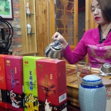 At the teap shop, demonstrating tea varities